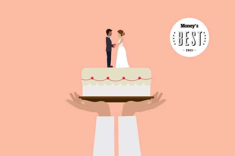 Hands Holding Up A Wedding Cake With A Bride And Groom On Top