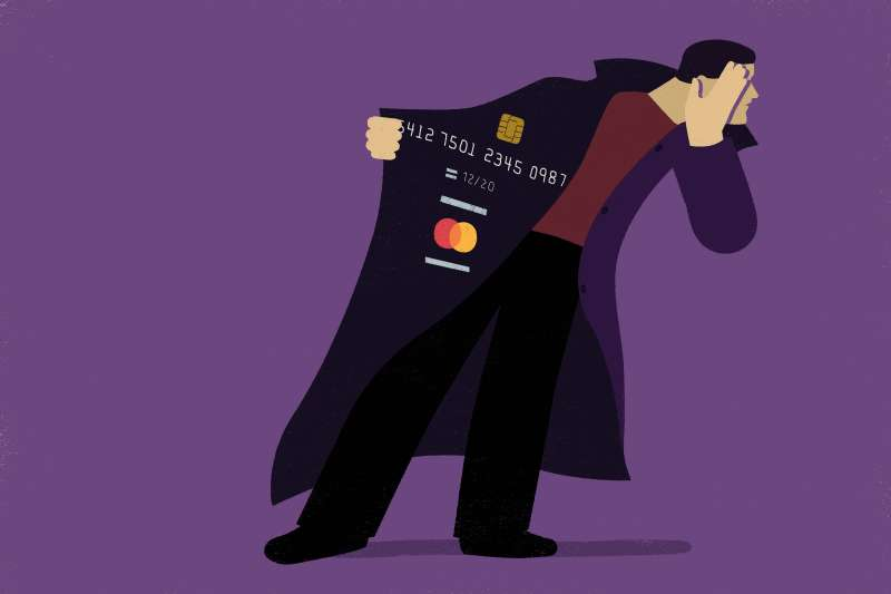 A thief is covering his face and showing the credit card number from his coat