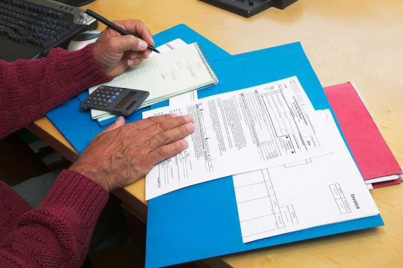 Man preparing his tax forms