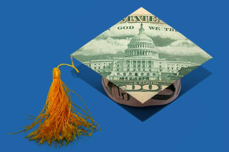 Money Origami Graduation CAP Folded with Real 50 Dollars Bill on a colored background