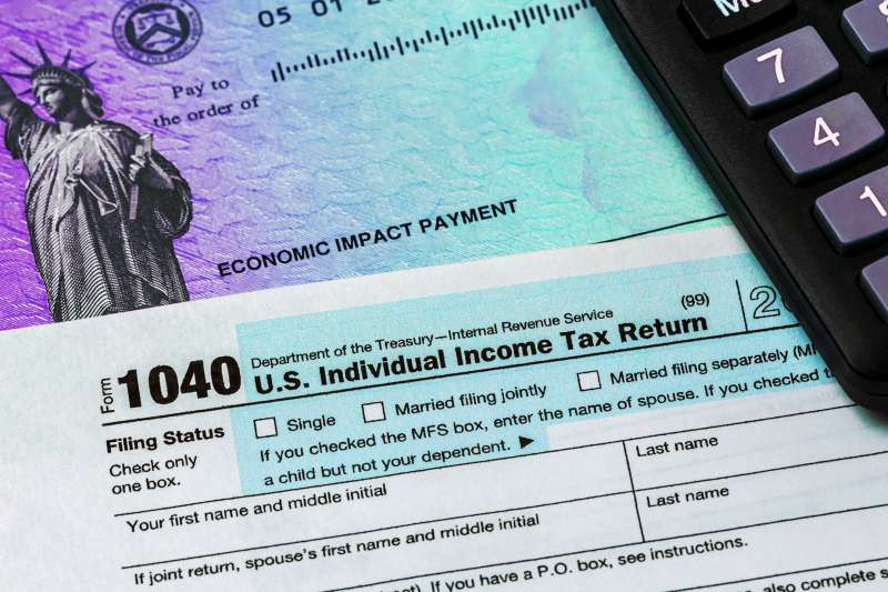 Stimulus Check, 1040 Tax form and a calculator