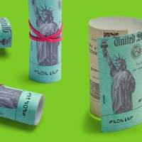 Four rolled up stimulus checks on a colored background