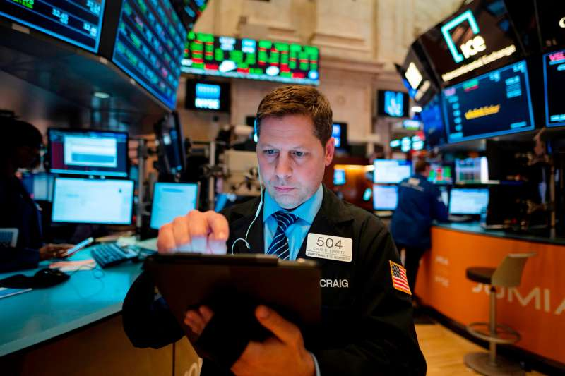 A trader works ahead of the closing bell on the floor of the New York Stock Exchange