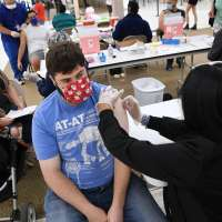 Young man getting vaccinated against Covid-19
