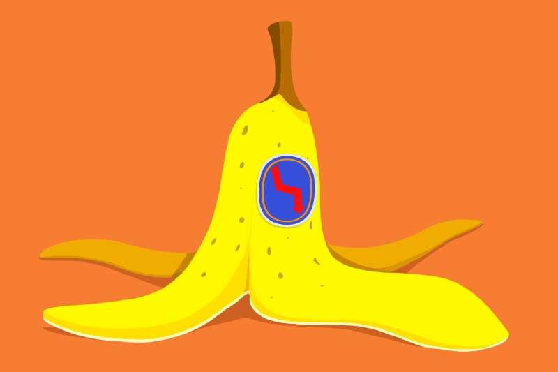 A banana peel with plummeting arrow sticker on it.