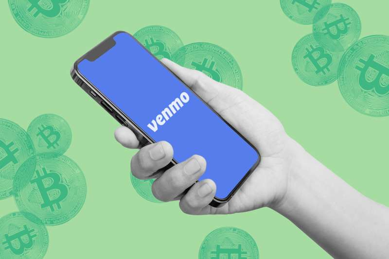 Venmo logo displaying on a phone screen with bitcoins in the background