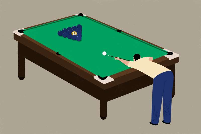 A person is playing pool with with one bitcoin ball in the mix.