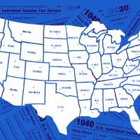 Map of the United States with a lot of 1040 Income Tax Forms in the Background.