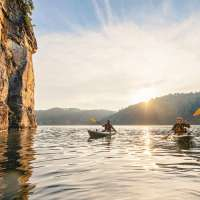 Couple Kayaking on Summersville Lake in West Virginia