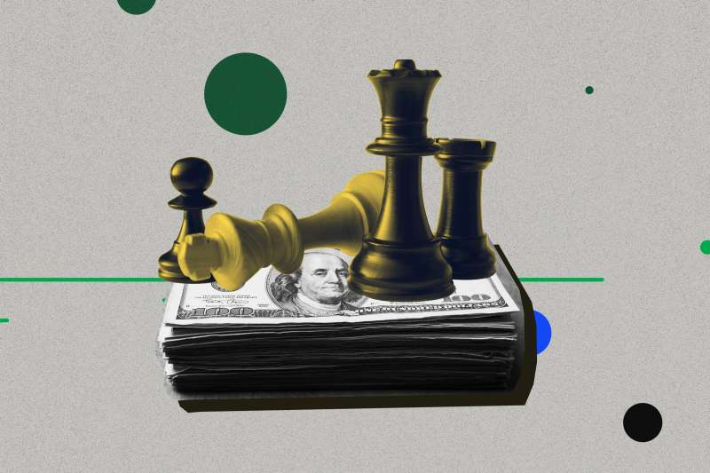 Chess piece sitting on top of a stack of money