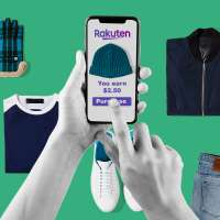 Hands with a phone, purchasing clothes and saving money through Rakuten app