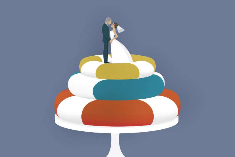 Bride And Groom On Top Of Wedding Cake Made Out Of Life Preservers