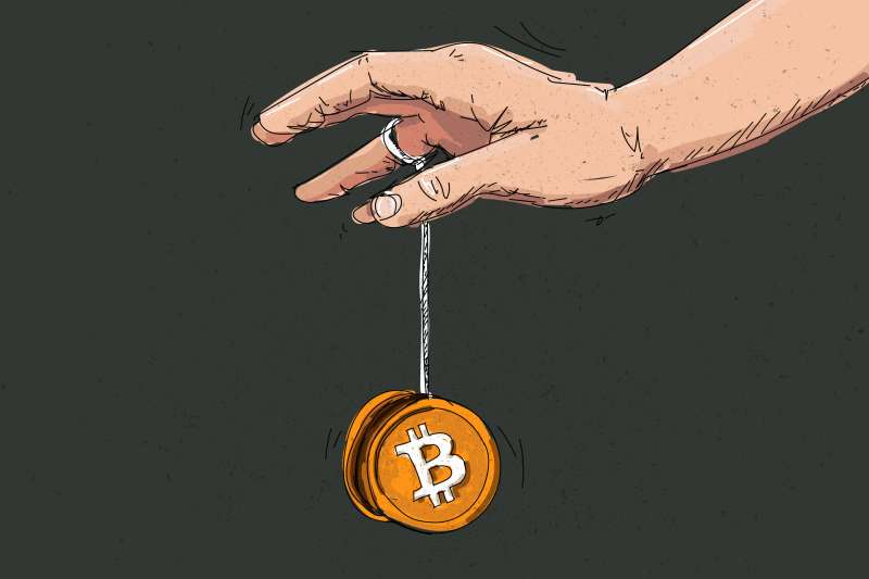 Hand Playing With A Bitcoin Shaped Yoyo