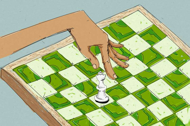 Hand Moving Chess Piece Across Board With Squares Made of Dollar Bills