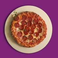Baked Pizza on a stone, on a colored background