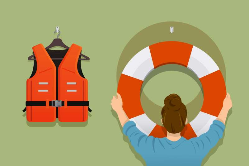 A person is choosing the life preserver, next to the life vest.