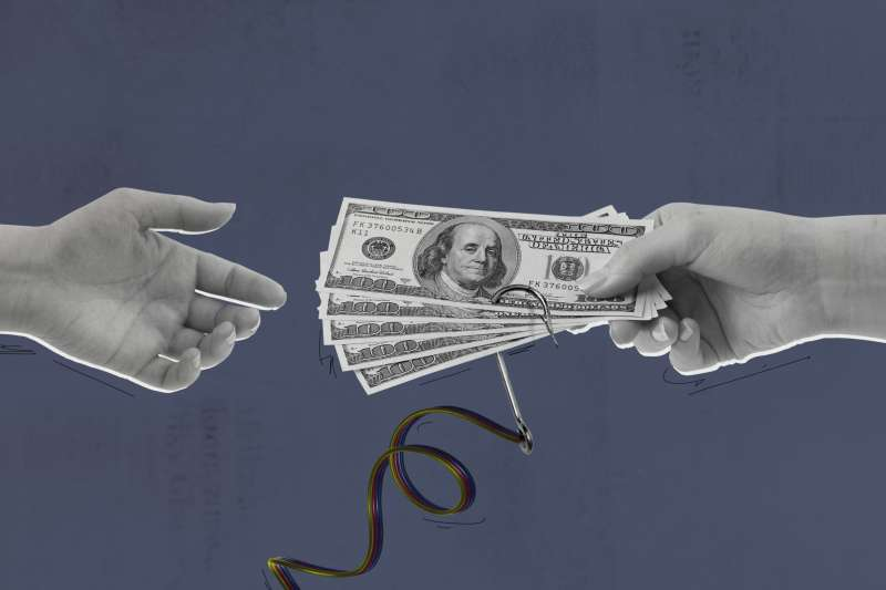Open Hand Receiving Cash That Has A Fish Hook Attached To The Bottom