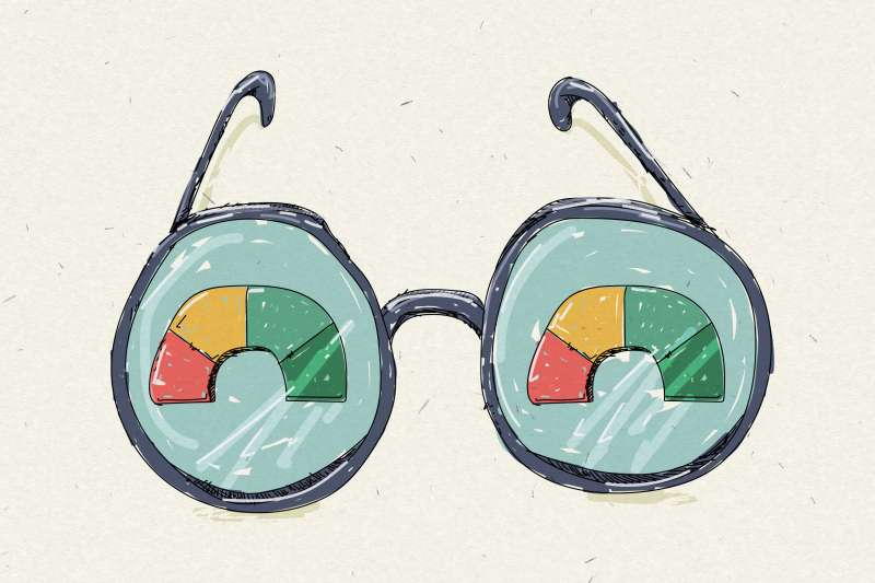 Glasses With A Reflection Of Credit Score Wheel