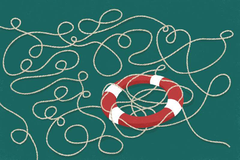 A life preserver ring with a long rope tangled around.