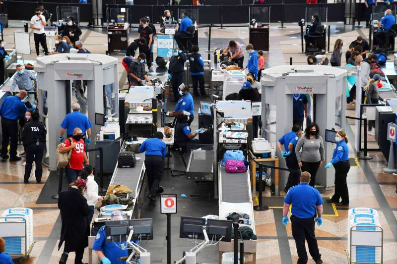 Transportation Security Administration crews are checking baggages of travelers at the security checking point at an airport