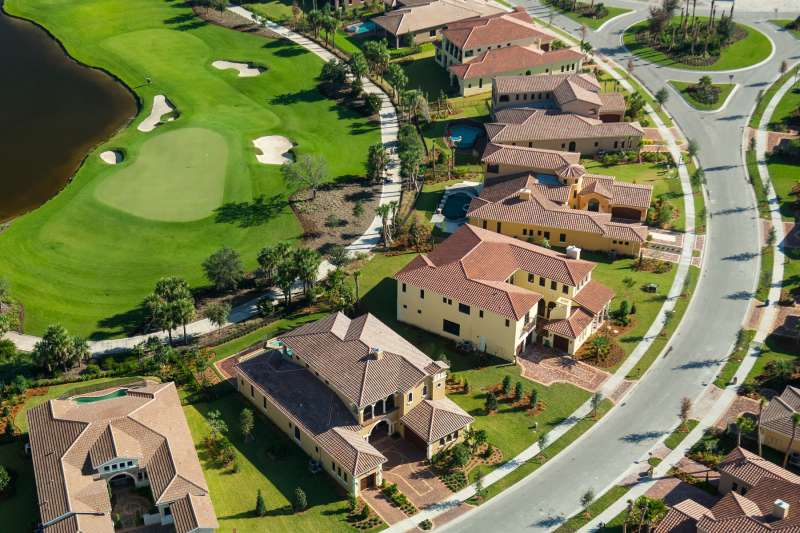 Aerial view of a row of lovely houses in a Florida golf community