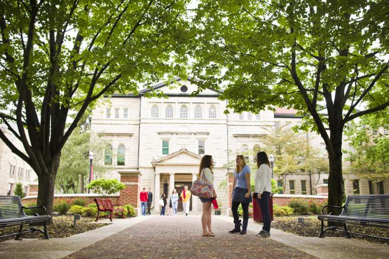 A group of students talking on the Ohio Wesleyan University campus