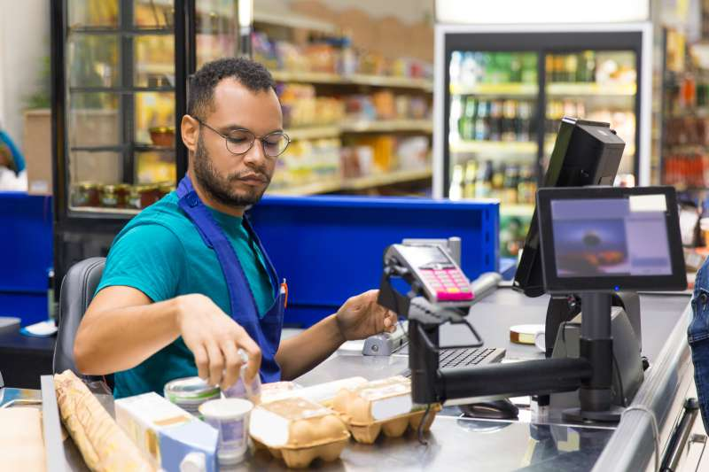 Cashier scanning groceries at checkout