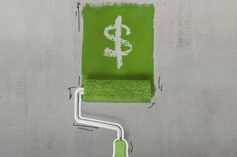 Paint Roller Painting A Dollar Sign On A Wall