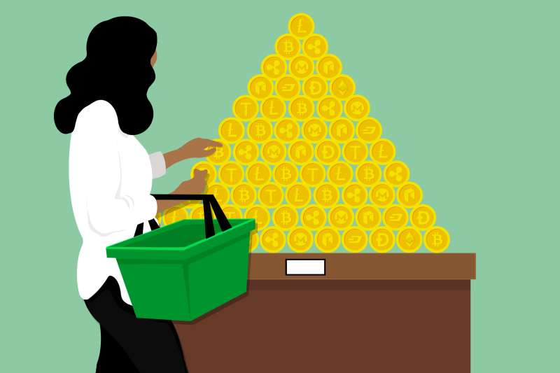 A woman with a shopping basket, looking for things to to place in it and contemplating a crypto coin display