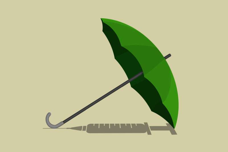 An umbrella on its side (green to represent the cost of the insurance) and its shadow is the shape of an unused vaccine.