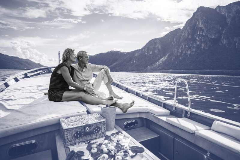 Senior couple enjoy time together on yacht