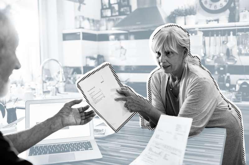Senior couple doing home finances in their kitchen