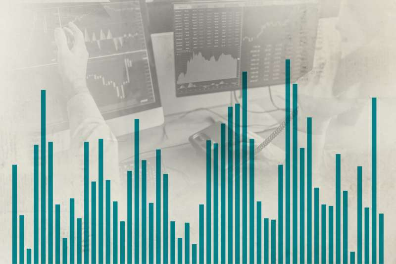 Stock Market Bar Chart Overlaid On Stock Traders In Front Of Computer