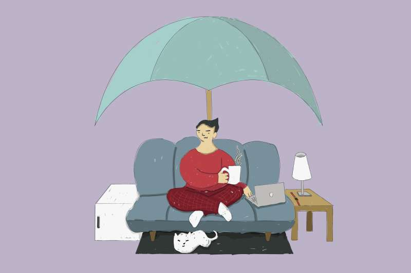 Oversized Umbrella Covering A Person Sitting On A Couch With A Mini Fridge Beside Them