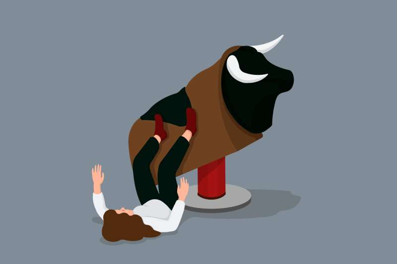 A woman is attempting to ride a mechanical bull (the market) but falling off to the ground.