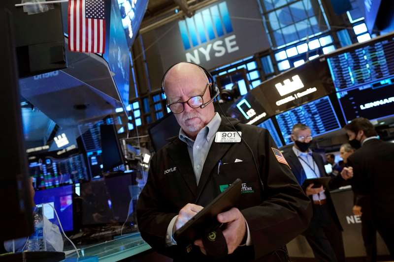 Trader John Doyle works on the floor of the New York Stock Exchange