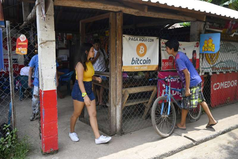 People are seen in a store where bitcoins are accepted in El Salvador