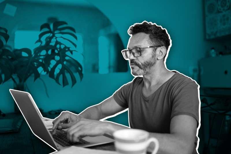 Hispanic Man Using A Laptop