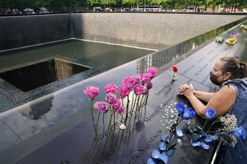 A mourner prays at the National September 11 Memorial and Museum in New York City