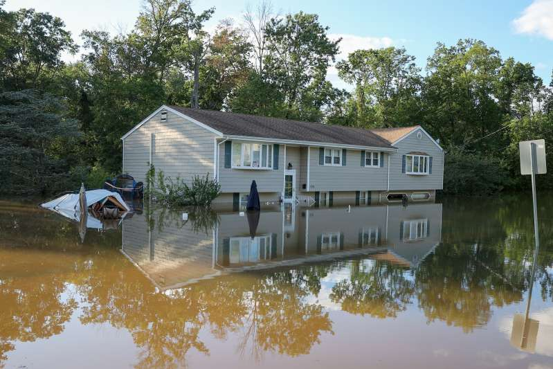 A view of a house surrounded by floodwater in New Jersey after Hurricane Ida