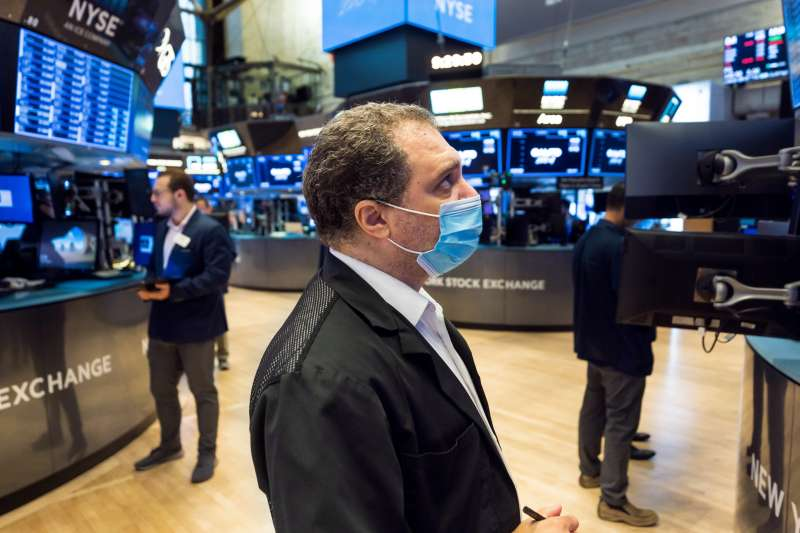 Traders work on the floor of the New York Stock Exchange in New York, USA, 06 August 2021