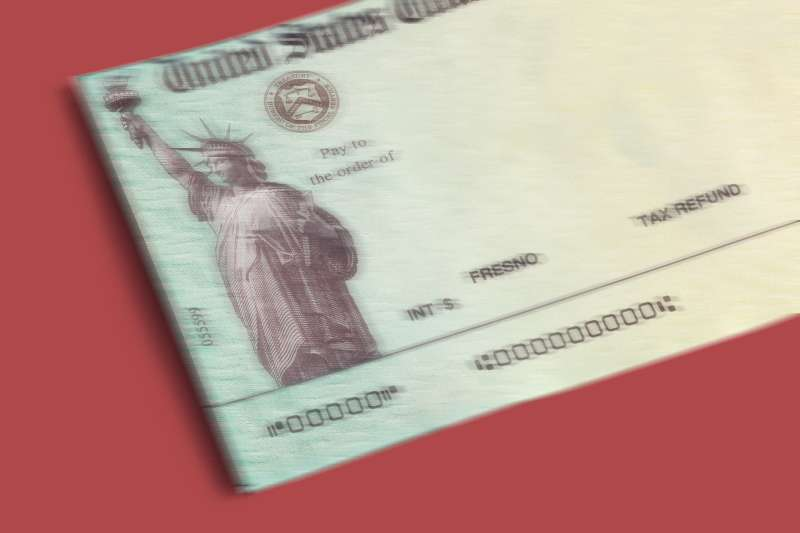 A blurry stimulus check on a red background