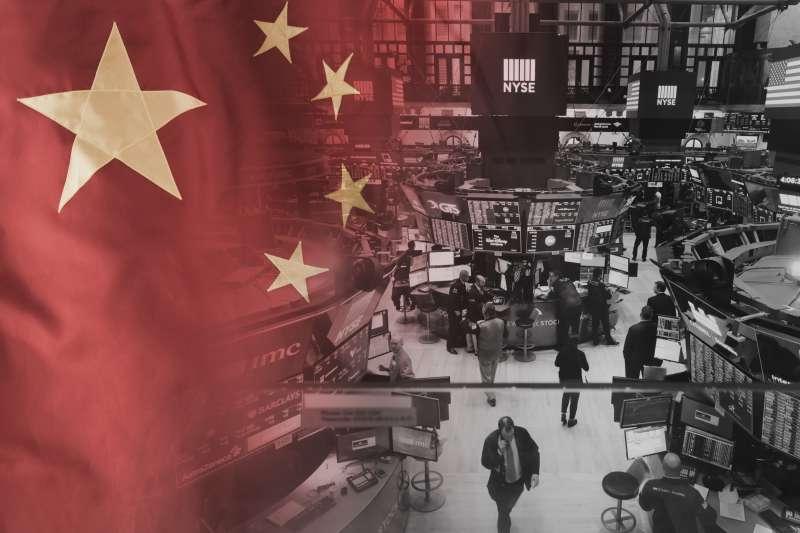 The Chinese flag mixed with a photo of traders working at the New York Stock Exchange