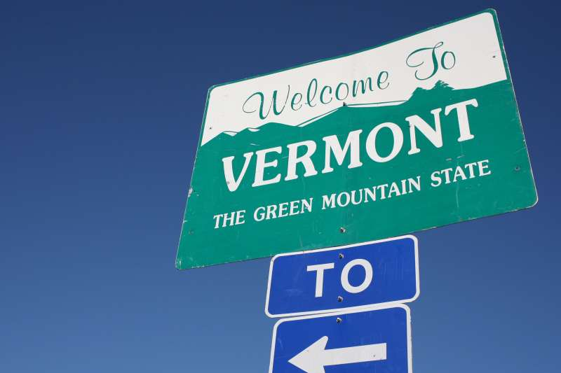 Photograph of a  Welcome To Vermont. The Green Mountain State  sign