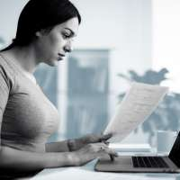 Woman filling out forms on her computer