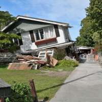 Collapsed house damaged by earthquake