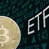Large Bitcoin Over A Stock Exchange Screen With The Letters ETF