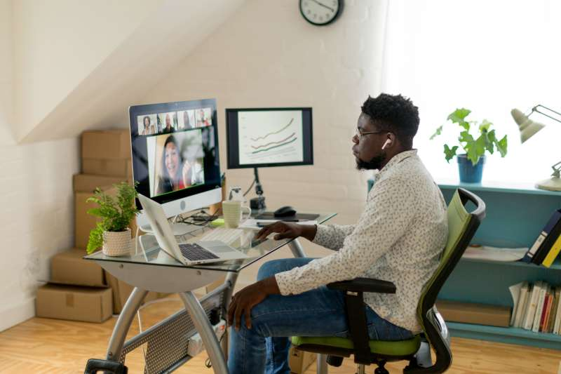 Businessman on video call from his home office