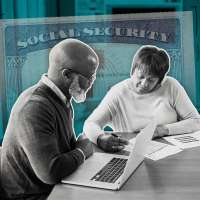 Couple Looking At Laptop And Paperwork With A Large Fading Social security card Behind Them