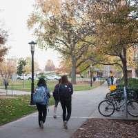 Students walk along University campus